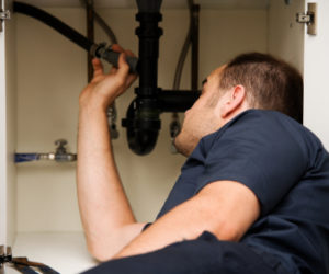 plumber repairing leak under sink harrisburg